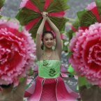 Young dancers perform during National Day celebrations marking the 101st anniversary of the founding of the Republic of China, R.O.C. in front of the Presidential Office in Taipei, Taiwan. During the celebrations, President Ma Ying-jeou pledged greater efforts to fix the island's economy, now limping along at about a 2 per cent annual growth rate. (AP Photo/Wally Santana)