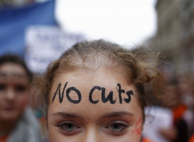 A teacher protesting against cuts during the week