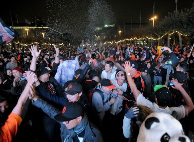 San Francisco Giants fans celebrate outside PacBell Park after their team won the 2012 Baseball World Series