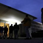 Voters stand in line before the sun rises to cast their votes at a polling precinct at the Wake County Firearms Education and Training Center in Apex, NC, on Election Day. (AP Photo/Gerry Broome)