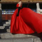 A Chinese bride poses a picture in front of the Emperor's Ancestral Temple during the 18th Communist Party Congress in Beijing, China. (AP Photo/Vincent Yu)