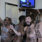 Naked AIDS activists, with painted slogans on their bodies, protest inside the lobby of the Capitol Hill office of House Speaker John Boehner prior to World AIDS Day. Three women AIDS activists saying they wanted to highlight the