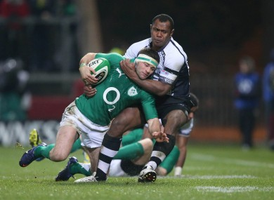 Fergus McFadden is tackled by Vereniki Goneva of Fiji.
