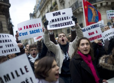 Young people hold placards during a protest organized by fundamentalist Christian group Civitas Institute against the gay marriage, in Paris