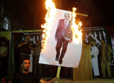 Palestinians march during a protest against president Mahmoud Abbas in the Jabaliya Refugee Camp, northern Gaza Strip Saturday, Nov. 3, 2012. 