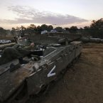 An Israeli soldier sleeps on a tank. (AP Photo/Lefteris Pitarakis)