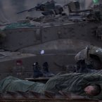 An Israeli soldier sleeps on a military vehicle. (AP Photo/Ariel Schalit)