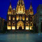 SPAIN Catalonia Barcelona The Cathedral.  Exterior facade and entrance illuminated at dusk.