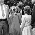 Drew Barrymore gives President Ronald Reagan a kiss after a ceremony at the White House in 1984 for a young astronaut program.