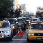Traffic backs up along the Crescent Street approach to the Queensboro Bridge as police check to ensure that motorists adhere to HOV (High Occupancy Vehicle) restrictions in the aftermath of superstorm Sandy (AP Photo/Jason DeCrow)