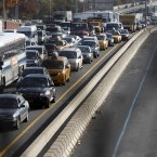 In a photo made through a chain-link fence, traffic is gridlocked on the Long Island Expressway into Manhattan near the turn off for the Queensboro Bridge (AP Photo/Jason DeCrow)