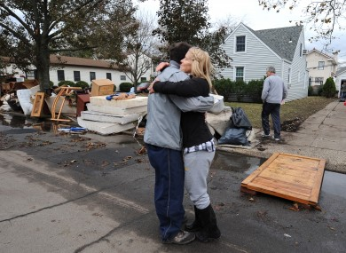 Beth Skudin, right, hugs a neighbor outside her home that was flooded by Superstorm Sandy, Thursday, Nov 1, 2012, in Long Beach, N.Y.