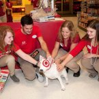 Target team members delighted by a visit from Bullseye, Target's mascot in Roseville, Minnesota. (Dawn Villella/AP Images For Target)