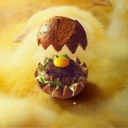 Nest of spinach, small burger, egg yolk -