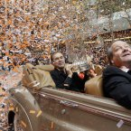 San Francisco Giants manager Bruce Bochy holds the World Series trophy as confetti falls during the baseball team's World Series victory parade, in San Francisco. (AP Photo/Jeff Chiu)