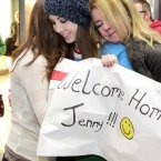 Jenny Flynn (23) from Navan is greeted by mother Jackie and sister Holly after traveling home from Singapore for Christmas today at Dublin Airport. Photo: Mark Stedman/Photocall Ireland