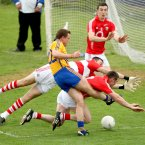 No way through. It's a notable Munster final appearance for Clare but they are decisively beaten by Cork. Here Rebels goalkeeper Alan Quirke along with the defensive pair of Noel O'Leary and Ray Carey, stop Clare's Niall Browne from finding the net. (INPHO/James Crombie).