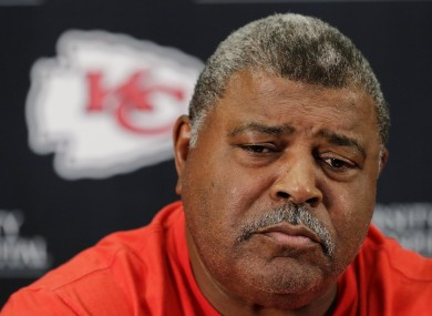 Romeno Crennel pauses while talking about the murder-suicide committed by linebacker Jovan Belcher.