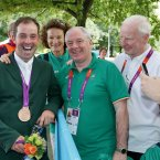 Junior Minister Ring gets to grips with Olympic Bronze Medal winner Cian O'Connor in London as Pat Hickey looks on. ©INPHO/Morgan Treacy