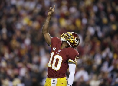 Washington Redskins quarterback Robert Griffin III celebrates a touchdown.