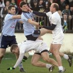 Diarmuid Connolly and James Kavanagh clash in a tempestuous affair in Newbridge for the O'Byrne Cup semi-final with 11 yellow cards flashed by referee Eddie Kinsella. Kildare eventually triumph. (INPHO/Donall Farmer)