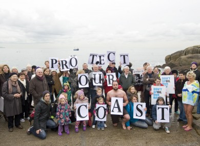 Protestors hold a demonstration at the Forty Foot in Dún Laoghaire against plans to drill for oil off Dalkey.