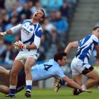 Keep an eye on it. Laois goalkeeper Eoin Culliton and John O'Loughlin follow the ball as Michael Darragh MacAuley scores the only crucial goal in their match in Croke Park. (INPHO/Donall Farmer).