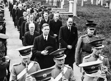 Taoiseach Eamon De Valera, who would later dismiss soldiers for desertion, and his cabinet with Irish soldiers in 1938.