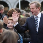 Taoiseach Enda Kenny greets school children after the ceremony. Image: Niall Carson/PA Wire