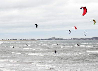 The heavy winds weren't bad news for everyone: kite surfers are seen enjoying the high coastal winds at Dollymount Strand yesterday.