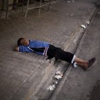 21 October: A Syrian boy sleeps on a sidewalk near Karma Jabl district in Aleppo.(AP Photo/ Manu Brabo)