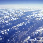 The snow covered Rocky Mountains with a thin layer of cloud seen from above at Montana Glacier National Park (Eye Ubiquitous/Press Association Images)
