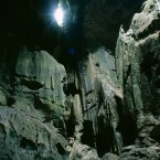 Malaysia, Borneo Niah Caves: a view of rocky interior lit by sunlight pouring through small opening in the roof of the cave (Eye Ubiquitous/Press Association Images)