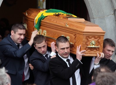 The coffin of Páidi Ó Sé is carried from the local parish church in Ventry, Co Kerry.
