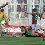 Keeping guard. Donegal netminder Paul Durcan saves the ball in the dying minutes of the game. With that Mayo hopes are extinguished and Donegal are closing in on success. (INPHO/Morgan Treacy).