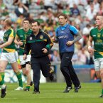 Half-time in a big game in Croke Park. Seamus McEnaney and Kieran McGeeney jog off the pitch to give their interval speeches. At full-time it is Banty who is celebrating after Meath's win. (INPHO/Donall Farmer).