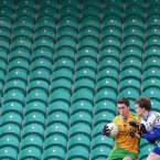 Not exactly a crowd-puller in Ballybofey. A lone spectator watches on as Stephen Griffin is tackled by Ronan McNally.