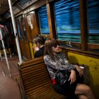 Passengers travel in a wooden carriage car on the historic subway system, Line A, in Buenos Aires, Argentina. The city government announced that the almost 100-year-old 'La Brugeoise