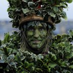 A member of the Bankside Mummers dresses as the 'Holly Man' as part of a Celebration of Twelfth Night performance near Shakespeare's Globe, Southwark, London.