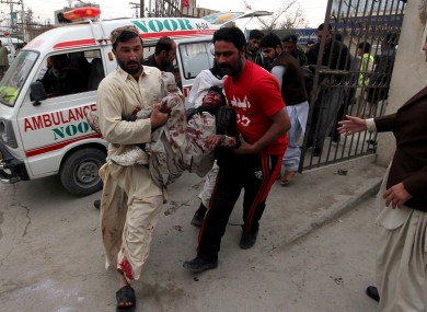 Pakistani volunteers rush an injured victim from a bomb blast in a commercial area to a local hospital in Quetta, Pakistan, Thursday, Jan. 10, 2013