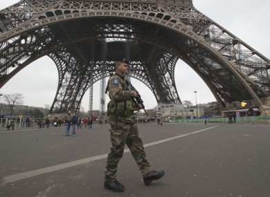 A French soldiers patrols infront of the Eiffel tower yesterday as France tightened security in public places following its intervention in Mali.