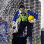 The Monaghan goalkeeper faces off with an intruder to his goalmouth.