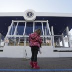 Evalina Lentini, of Ohio, looks at the Presidential viewing stand near the White House on Pennsylvania Avenue. (AP Photo/Steve Helber)