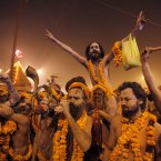 Naked Hindu holy men or a Naga Sadhus leave from their camp for a dip at Sangam. (AP Photo /Rajesh Kumar Singh)