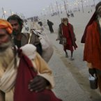 Indian Hindu holy men, or Sadhus, arrive at Sangam. (AP Photo/Kevin Frayer)