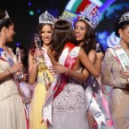 Rizzini Alexis Gomez, second from right, of Philippines is congratulated by other contestants following her win at the Miss Tourism International 2012 World Final in Malaysia. (AP Photo/Lai Seng Sin)