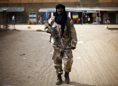 Chadian troops patrol the streets of Gao, northern Mali, yesterday