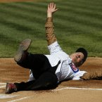 Bill Murray slides into home after rounding the bases before throwing out a ceremonial first pitch before an opening day baseball game between the Chicago Cubs and the Washington Nationals. (AP Photo/Charles Rex Arbogast)