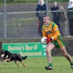 Neil Gallagher of Donegal keeps his focus while in possession despite the nearby distraction.