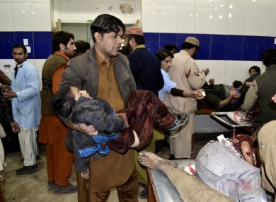 A Pakistani child who was injured in a bomb blast is brought to a hospital for treatment in Quetta